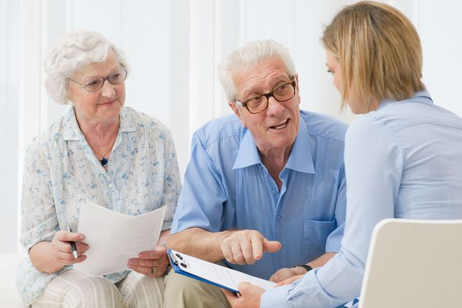 An elderly couple having a client consultation