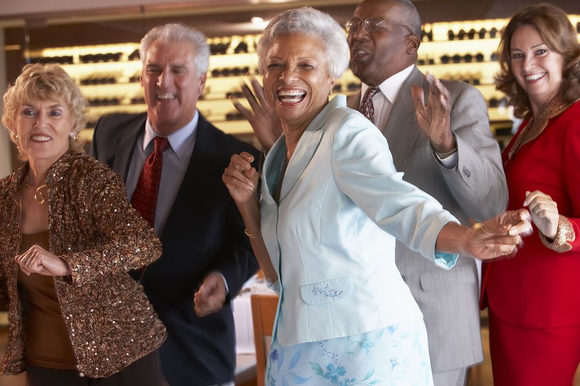 A group of elderly couples dancing